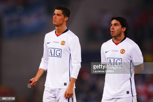 Carlos Tevez of Manchester United and Cristiano Ronaldo of Manchester United look dejected after Barcelona won the UEFA Champions League Final match...