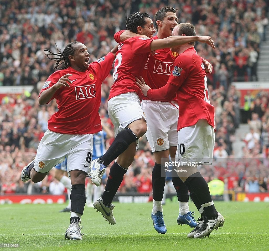 Carlos Tevez of Manchester United celebrates scoring their first goal during the Barclays FA Premier League match between Manchester United and Wigan Athletic at Old Trafford on October 6 2007, in Manchester, England.