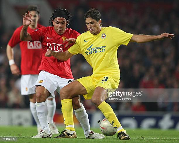 Carlos Tevez of Manchester United challenges Edmilson of Villarreal during the UEFA Champions League match between Manchester United and Villarreal...