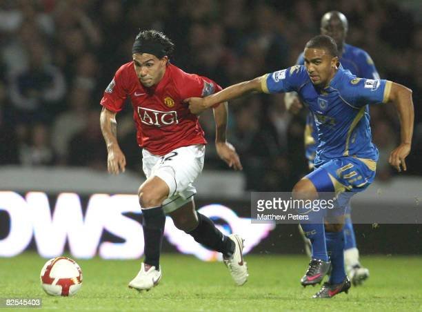 Carlos Tevez of Manchester United challenges Jerome Thomas of Portsmouth during the FA Premier League match between Portsmouth and Manchester United...
