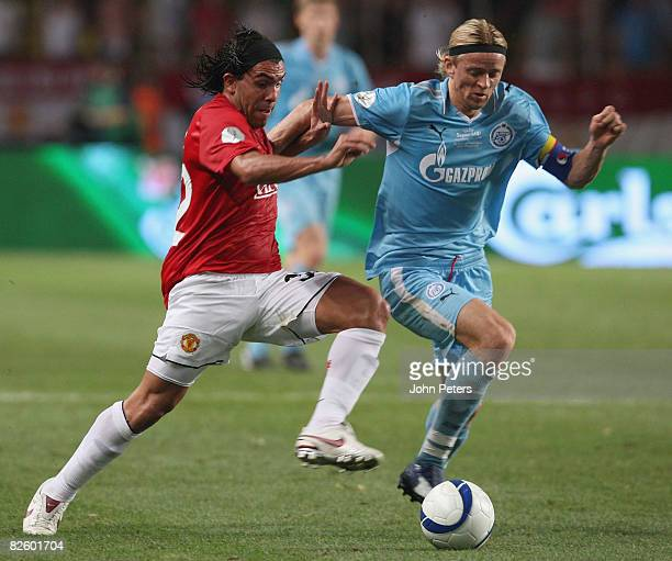 Carlos Tevez of Manchester United clashes with Anatoliy Tymoshchuk of Zenit St Petersburg during the UEFA Supercup match between Manchester United...