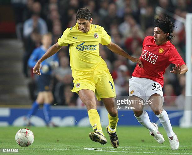 Carlos Tevez of Manchester United clashes with Edmilson of Villarreal during the UEFA Champions League match between Manchester United and Villarreal...