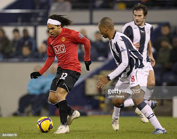 Carlos Tevez of Manchester United clashes with Pele of West Bromwich Albion during the Barclays Premier League match between West Bromwich Albion and...