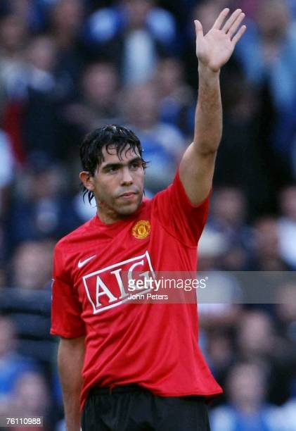 Carlos Tevez of Manchester United waves to the away fans during the Barclays FA Premier League match between Portsmouth and Manchester United at...