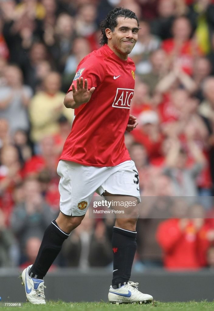 Carlos Tevez of Manchester United waves to the fans as he leaves the pitch during the Barclays FA Premier League match between Manchester United and Wigan Athletic at Old Trafford on October 6 2007, in Manchester, England.