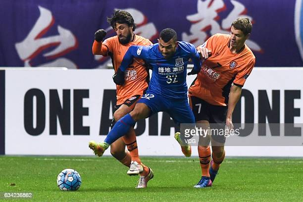 Carlos Tevez of Shanghai Shenhua and Thomas Broich Thomas Kristensen of Brisbane Roar compete for the ball during the AFC Champions League 2017...