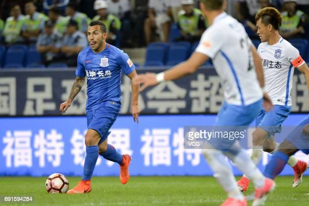 Carlos Tevez of Shanghai Shenhua drives the ball during 2017 Chinese Super League 12th round match between Tianjin Teda and Shanghai Shenhua at...