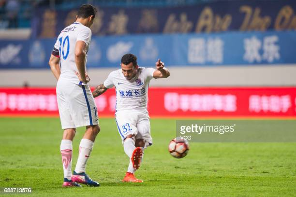 Carlos Tevez of Shanghai Shenhua takes a free kick during the 11th round match of China Super League between Guangzhou RF and Shanghai Shenhua at...