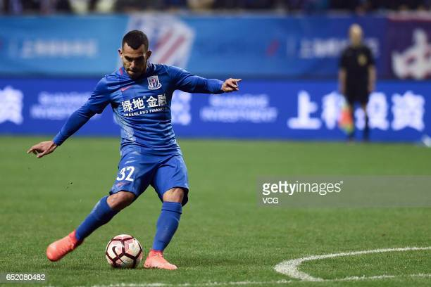 Carlos Tevez of Shanghai Shenhua takes a free kick during the 2nd round match of CSL Chinese Football Association between Shanghai Shenhua and...
