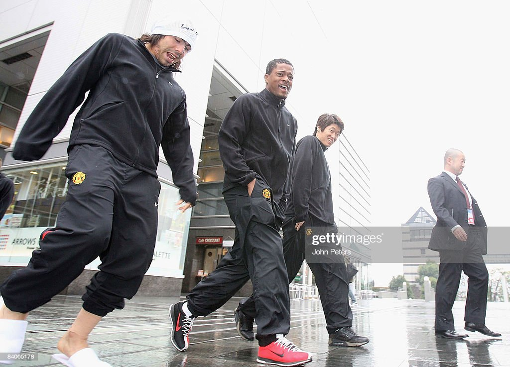 Carlos Tevez, Patrice Evra and Ji-Sung Park of Manchester United have a walk around Yokohama ahead of a First Team Training Session ahead of the World Club Cup on December 17 2008 in Yokohama, Japan.