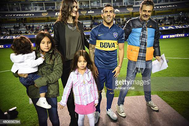Carlos Tevez poses for pictures during his presentation as new player of Boca Juniors at Alberto J Armando Stadium on July 13 2015 in Buenos Aires...