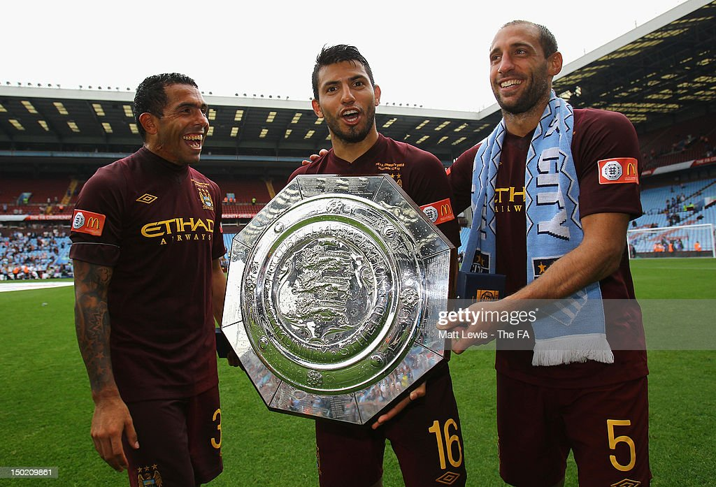 <a gi-track='captionPersonalityLinkClicked' href=/galleries/search?phrase=Carlos+Tevez&family=editorial&specificpeople=220555 ng-click='$event.stopPropagation()'>Carlos Tevez</a> (L) <a gi-track='captionPersonalityLinkClicked' href=/galleries/search?phrase=Sergio+Aguero&family=editorial&specificpeople=1100704 ng-click='$event.stopPropagation()'>Sergio Aguero</a> and Pablo Zabaleta (R) of Manchester City celebrate with the trophy after their team's victory at the end of the FA Community Shield match between Manchester City and Chelsea at Villa Park on August 12, 2012 in Birmingham, England.