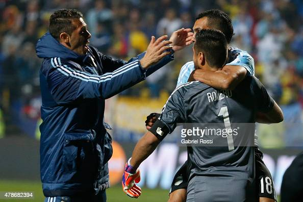 Carlos Tevez Sergio Romero and Martin Demichelis of Argentina celebrate after the 2015 Copa America Chile quarter final match between Argentina and...