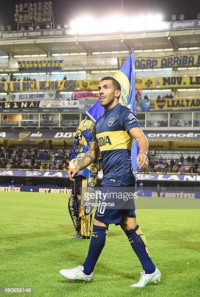 Carlos Tevez walks on the field during his presentation as new player of Boca Juniors at Alberto J Armando Stadium on July 13 2015 in Buenos Aires...