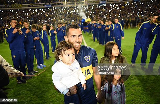Carlos Tevez walks on the field with his daughters during his presentation as new player of Boca Juniors at Alberto J Armando Stadium on July 13 2015...