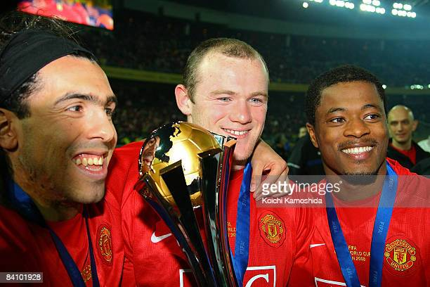 Carlos Tevez Wayne Rooney and Patrice Evra of Manchester United holds the FIFA Club World Cup Japan 2008 trophy after the final match between...
