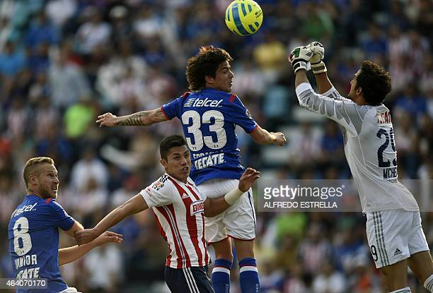 Carlos Tofolo Junior and Mauro Formica of Cruz Azul vie for the ball with Carlos Salcedo and goalkeeper Michel Vergara of Chivas during their Mexican...