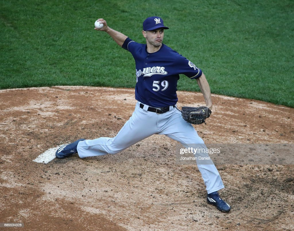Carlos Torres #59 of the Milwaukee Brewers pitches in the 9th inning against the Chicago Cubs at Wrigley Field on May 19, 2017 in Chicago, Illinois. The Brewers defeated the Cubs 6-3.