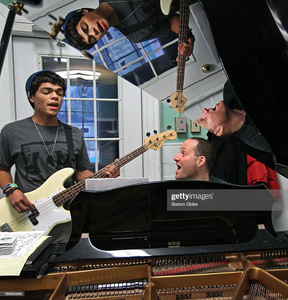 Carlos Trinidad, left, and music director Aaron Z. Katz, right, during a music session at the Plummer Home for Boys.
