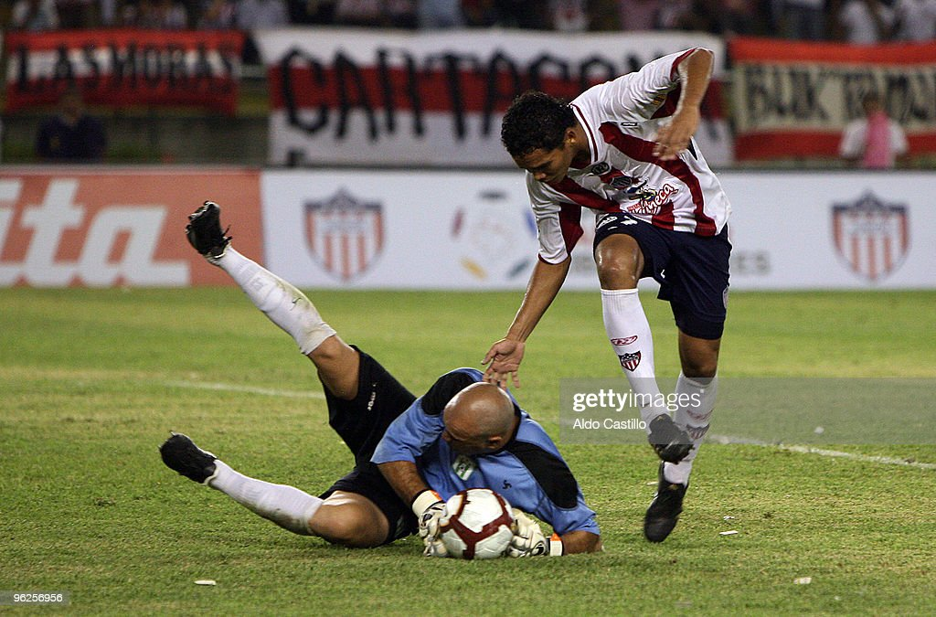 Carlos Vaca (R) of Colombia's Junior figths for the ball with Jorge Contreras goalkeeper of Uruguay's Racing during their match as part of the Santander Libertadores Cup 2010 at Metropolitano Roberto Melendez Stadium on January 28, 2010 in Barranquilla, Colombia.