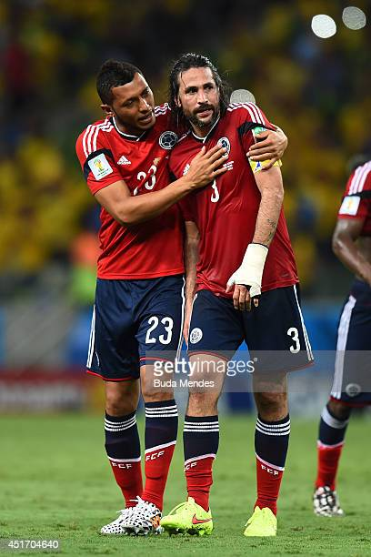 Carlos Valdes and Mario Yepes of Colombia react after being defeated by Brazil 21 during the 2014 FIFA World Cup Brazil Quarter Final match between...