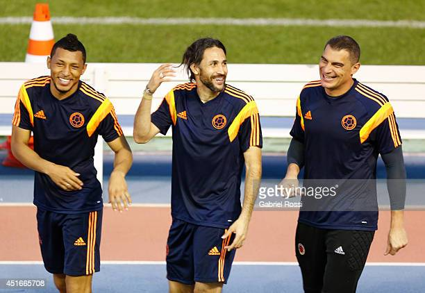 Carlos Valdez Mario Yepes and Farid Mondragon of Colombia joke during a training session at Universidad de Fortaleza Stadium on July 03 2014 in...