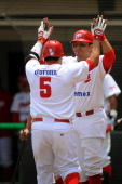 Carlos Valencia and Oscar Robles of Mexico Red Devils celebrate during a 2010 Liga Mexicana de Beisebol match between Mexico Red Devils and Vaqueros...