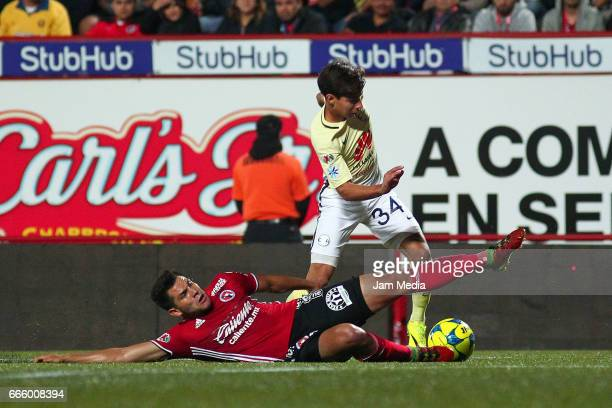 Carlos Vargas of Tijuana and Diego Lainez of America fight for the ball during the 13th round match between Tijuana and America as part of the Torneo...
