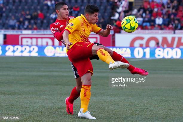 Carlos Vargas of Tijuana and Gaston Lezcano of Morelia fight for the ball during the quarter finals second leg match between Tijuana and Morelia as...
