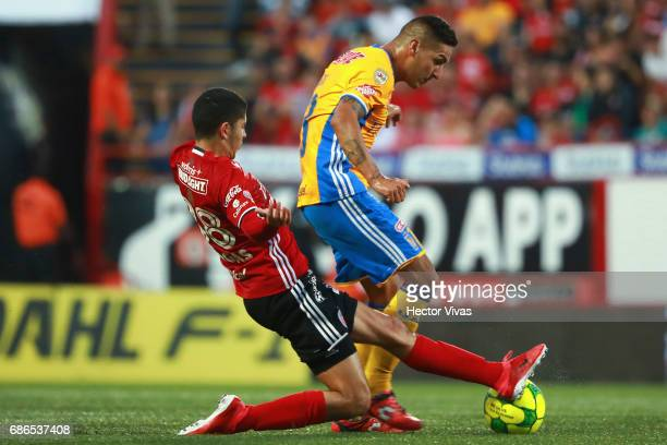 Carlos Vargas of Tijuana struggles for the ball with Ismael Sosa of Tigres during the semi final second leg match between Tijuana and Tigres UANL as...