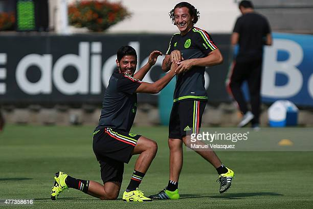 Carlos Vela and Andres Guardado joke during a Mexico National Team training session prior the beginning of Gold Cup 2015 at CAR on June 16 2015 in...