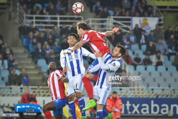Carlos Vela and Juanmi of Real Sociedad duels for the ball with Fernando Amorebieta of Sporting Gijon during the Spanish league football match...