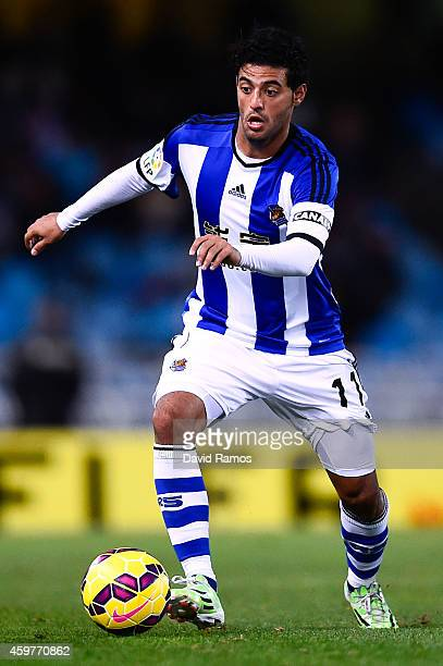 Carlos Vela Garrido of Real Sociedad runs with the ball during the La Liga match between Real Socided and Elche FC at Estadio Anoeta on November 28...
