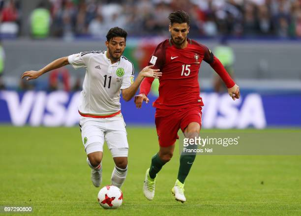 Carlos Vela of Mexico and Andre Gomes of Portugal battle for possession during the FIFA Confederations Cup Russia 2017 Group A match between Portugal...