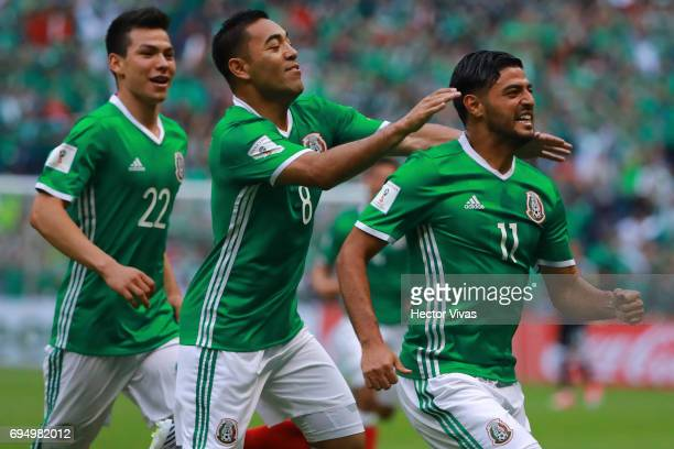 Carlos Vela of Mexico celebrates with teammates after scoring the first goal of his team during the match between Mexico and The United States as...