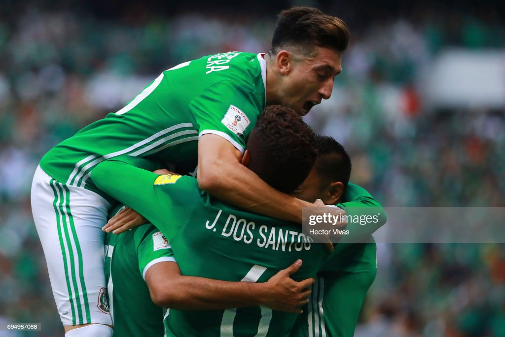 Carlos Vela of Mexico celebrates with teammates after scoring the first goal of his team during the match between Mexico and The United States as part of the FIFA 2018 World Cup Qualifiers at Azteca Stadium on June 11, 2017 in Mexico City, Mexico.
