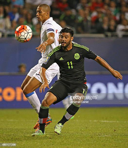 Carlos Vela of Mexico chases the ball with Jeniel Marquez of Cuba during a match in the 2015 CONCACAF Gold Cup at Soldier Field on July 9 2015 in...