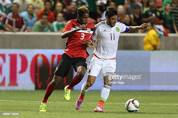 Carlos Vela of Mexico fights for the ball with Joevin Jones of Trinidad and TObago during a friendly match between Mexico and Trinidad and Tobago at...