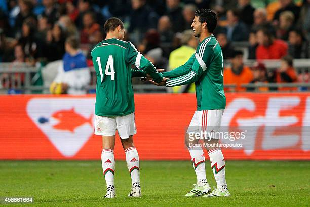 Carlos Vela of Mexico is congratulated by team mate Javier Hernandez after scoring the second goal of the game for his team during the international...
