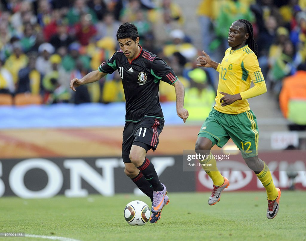 <a gi-track='captionPersonalityLinkClicked' href=/galleries/search?phrase=Carlos+Vela&family=editorial&specificpeople=2217707 ng-click='$event.stopPropagation()'>Carlos Vela</a> of Mexico with <a gi-track='captionPersonalityLinkClicked' href=/galleries/search?phrase=Reneilwe+Letsholonyane&family=editorial&specificpeople=5458900 ng-click='$event.stopPropagation()'>Reneilwe Letsholonyane</a> of South Africa during the 2010 FIFA World Cup South Africa Group A match between South Africa and Mexico at Soccer City Stadium on June 11, 2010 in Johannesburg, South Africa. The match was drawn 1-1.