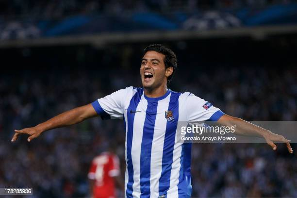 Carlos Vela of Real Sociedad celebrates scoring their second goal during the UEFA Champions League Playoffs second leg match between Real Sociedad...