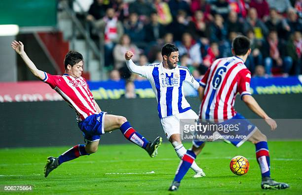 Carlos Vela of Real Sociedad duels for the ball with Jorge Mere of Real Sporting de Gijon during the La Liga match between Real Sporting de Gijon and...