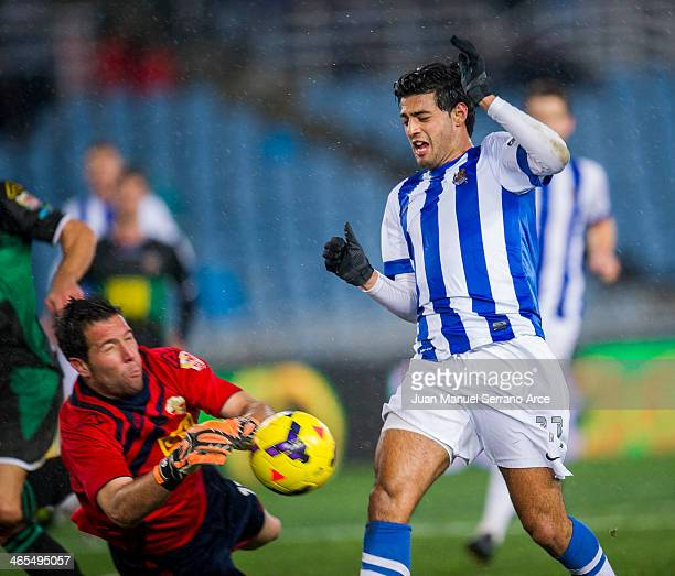 Carlos Vela of Real Sociedad duels for the ball with Tono Martinez of Elche FC during the La Liga match between Real Sociedad de Futbol and Elche FC...