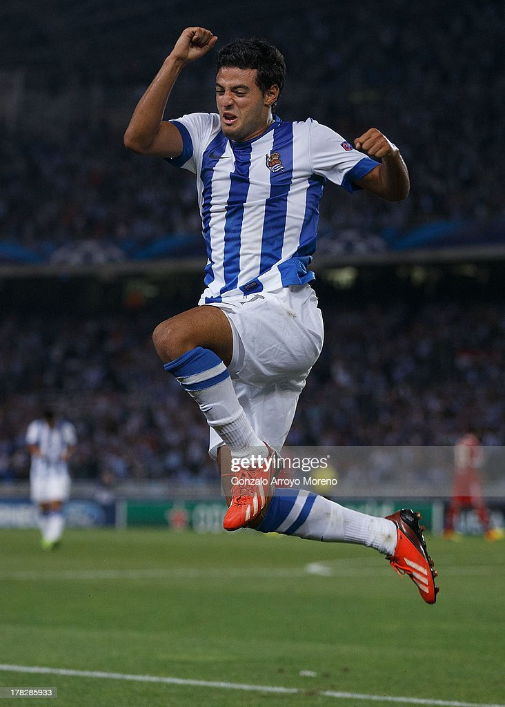 <a gi-track='captionPersonalityLinkClicked' href=/galleries/search?phrase=Carlos+Vela&family=editorial&specificpeople=2217707 ng-click='$event.stopPropagation()'>Carlos Vela</a> of Real Sociedad jumps while celebrating scoring their second goal during the UEFA Champions League Play-offs second leg match between Real Sociedad and Olympique Lyonnais at Estadio Anoeta on August 28, 2013 in San Sebastian, Spain.
