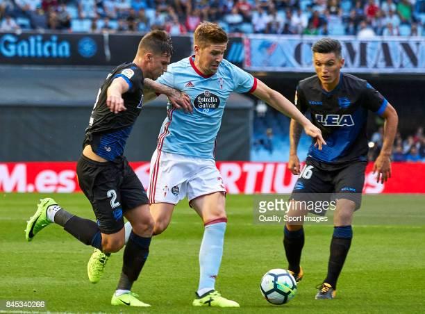 Carlos Vigaray of Deportivo Alaves competes for the ball with Andreu Fontas of Celta de Vigo during the La Liga match between Celta de Vigo and...
