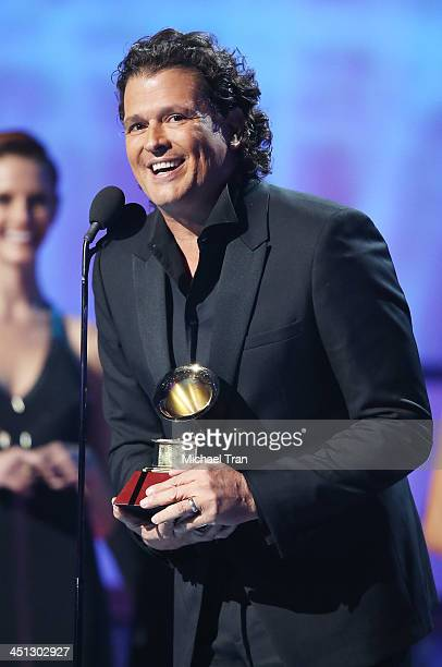 Carlos Vives accepts the Best Tropical Fusion Album GRAMMY Award for 'Corazn Profundo' onstage during the 14th Annual Latin GRAMMY Awards held at...