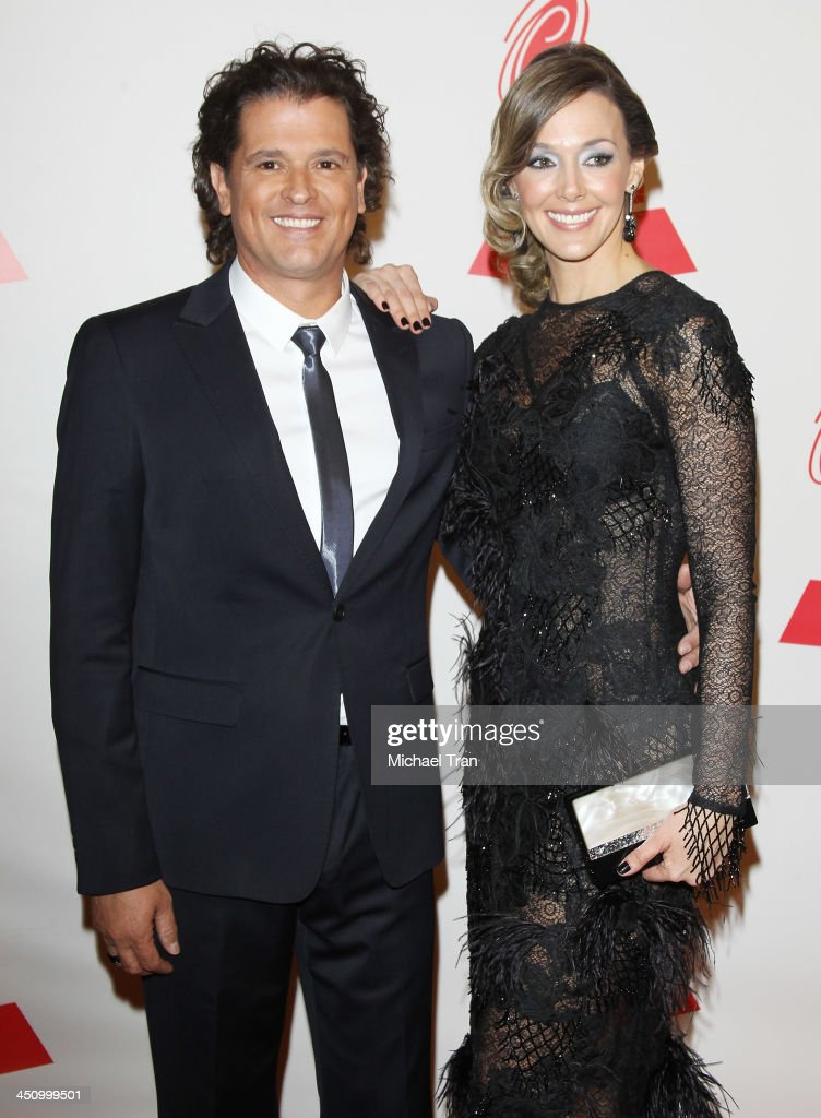 <a gi-track='captionPersonalityLinkClicked' href=/galleries/search?phrase=Carlos+Vives&family=editorial&specificpeople=235771 ng-click='$event.stopPropagation()'>Carlos Vives</a> (R) and guest arrive at the 2013 Latin Recording Academy Person of the Year honoring Miguel Bose held at Mandalay Bay Resort and Casino on November 20, 2013 in Las Vegas, Nevada.