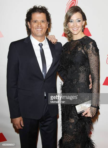 Carlos Vives and guest arrive at the 2013 Latin Recording Academy Person of the Year honoring Miguel Bose held at Mandalay Bay Resort and Casino on...