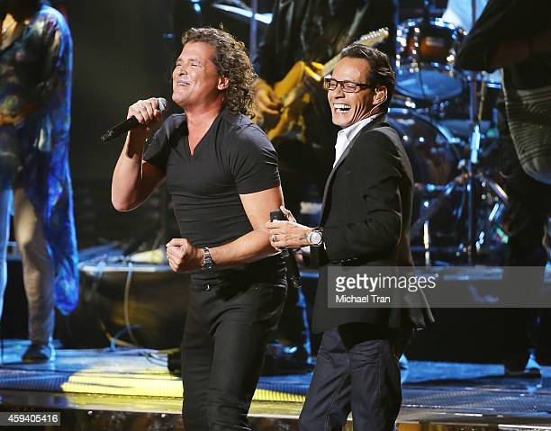 Carlos Vives and Marc Anthony perform onstage during the 15th Annual Latin GRAMMY Awards held at the MGM Grand Arena on November 20 2014 in Las Vegas...