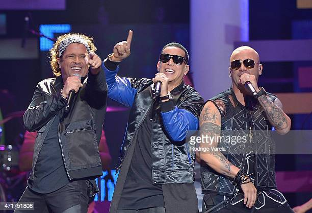 Carlos Vives Daddy Yankee and Wisin perform onstage at the 2015 Billboard Latin Music Awards presented bu State Farm on Telemundo at Bank United...